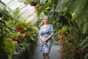 Siobhan Quayle, Group general Manager,Regulatory Systems and Operations standing in the Begonia House, Wellington Botanic Gardens